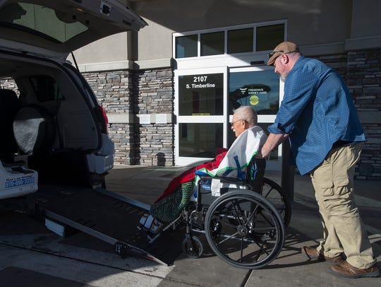 Jason Brabson assists Lee McKenzie, 79, while transporting