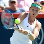 Bouchard earns 3-set victory in Montreal