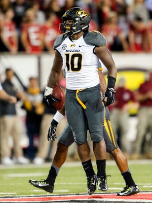 """FILE - In this Saturday, Sept. 12, 2015, file photo, Missouri linebacker Kentrell Brothers (10) celebrates after he intercepted an Arkansas State pass during the second half of an NCAA college football game in Jonesboro, Ark. Brothers often wears a T-shirt bearing the acronym FEWDM, or """"For Everyone Who Doubts Me."""" The Guthrie, Okla., native, who leads the naton in tackles, is starting to get some recognition. (AP Photo/Gareth Patterson, File)"""