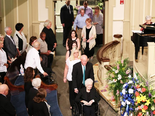 4 The family of Libby Murphy enters the sanctuary of First United Methodist Church Sunday afternoon for her funeral service.