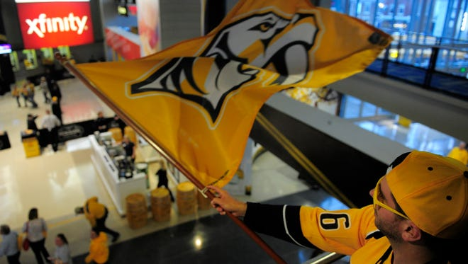 Fan Maverick (he goes by first name only) waves a Preds flag before the game at Bridgestone Arena Tuesday April 19, 2016, in Nashville, Tenn.