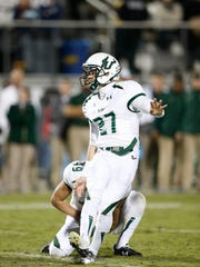 Marvin Kloss (27) of USF kicked two field goals against UCF in Orlando in 2013. Kloss went on to become a financial adviser after back surgeries ended his professional hopes. Now he's starting MedZoomer, an on-demand prescription delivery service.