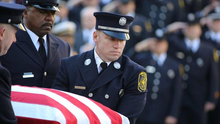 The body of Daryl Gordon is carried from Engine 14