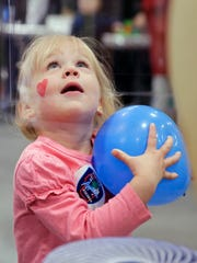 Hayden Gollner watches a balloon take flight at the second annual Fox Cities Kidz Expo at the Fox Cities Exhibition Center in 2018.