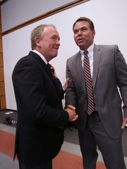 University of Louisville interim President Greg Postel, left, congratulated Vince Tyra after he was announced the acting athletic director for the university.Oct. 3, 2017