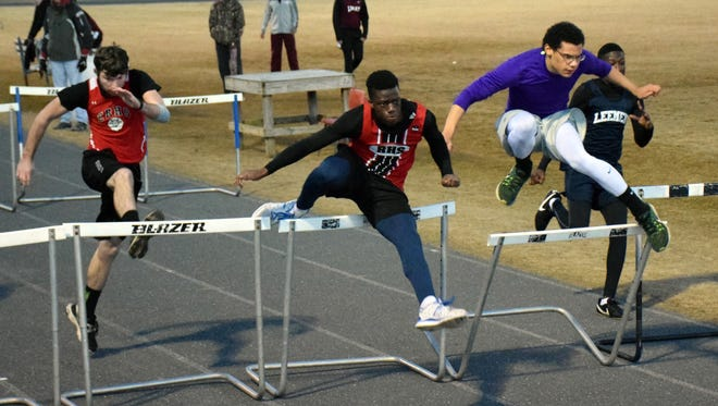 Riverheads' Joshua Akinwumi, center, stays ahead of Robert E. Lee's Romario Thompson, far right, Waynesboro's JaQue Patterson, second from right, and East Rockingham's Isaiah Fields, left, during a heat of the 55-meter high hurdles at a Polar Bear track meet at Fort Defiance High School on Wednesday, Jan. 18, 2017.