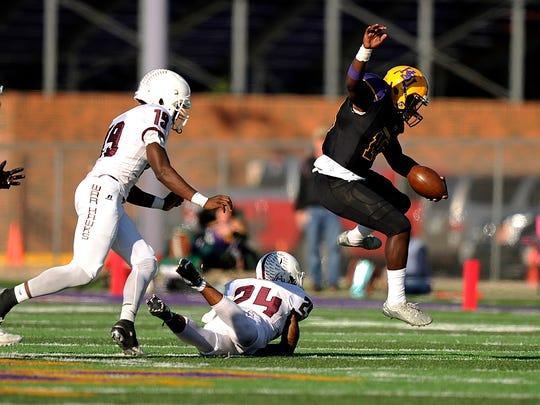 Hardin-Simmons running back Zai Zai Smith (19) hurdles McMurry defensive back Jordan Washington (24) during the fourth quarter of the Cowboys' 47-17 win on Saturday, Nov. 12, 2016, at HSU's Shelton Stadium. Hemphill scored a school-record six touchdowns in the game.