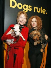 In this photo released by Pedigree, actresses Mary Tyler Moore (left) and Bernadette Peters hold adoptable dogs in 2008 during an event to raise funds and awareness for dog adoption