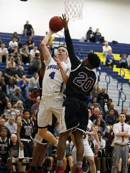 Gill St. Bernard's Paul Mulcahy goes to the basket against Rutgers Prep's Nahshon Battle during the Somerset County Tournament final on Feb. 25, 2017.