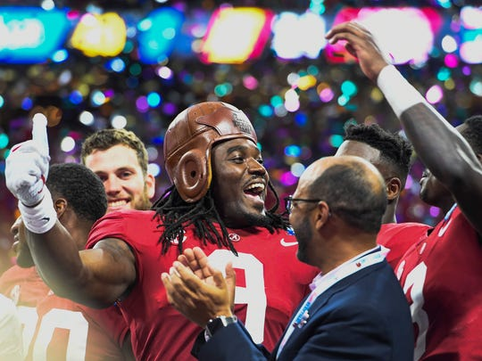 Alabama running back Bo Scarbrough (9) wears the old leather helmut after Alabama defeated Florida State in the Chick-fil-a Classic at the Mercedes - Benz Stadium in Atlanta, Ga., on Saturday September 2, 2017. (Mickey Welsh / Montgomery Advertiser)