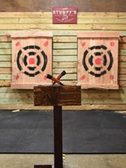 At Stumpy's Hatchet House, participants throw axes