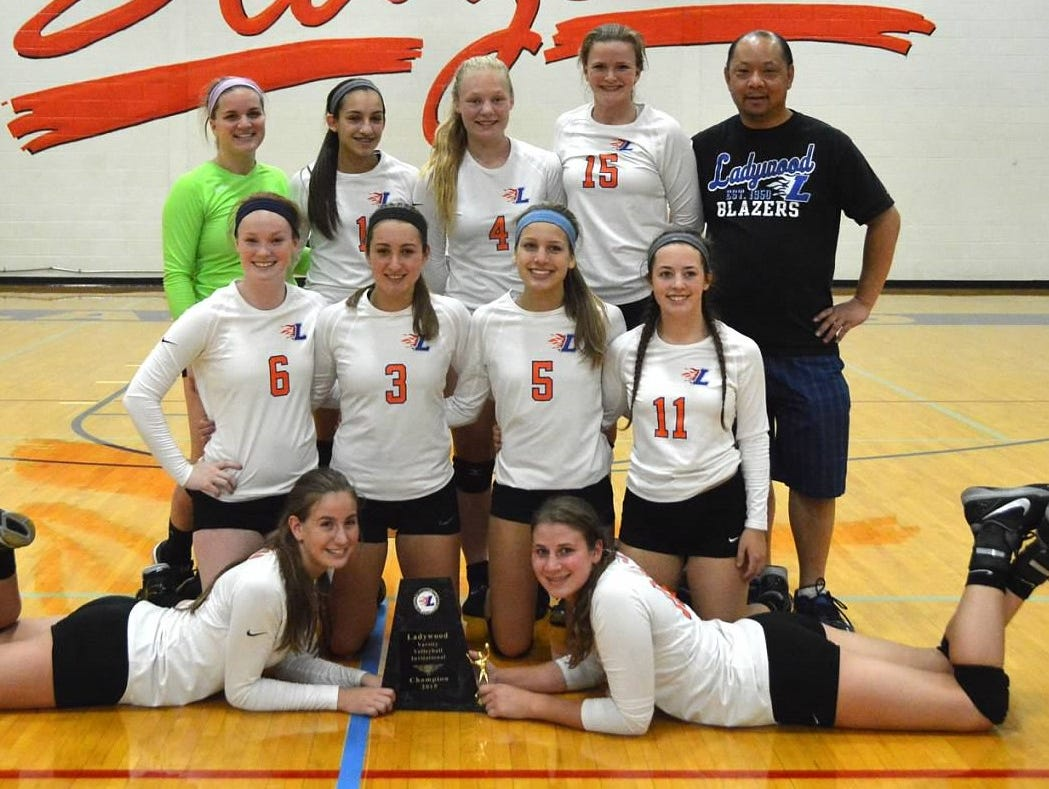 Members of Ladywood's volleyball team pose with the first-place trophy following Saturday's Blazer Invitational.