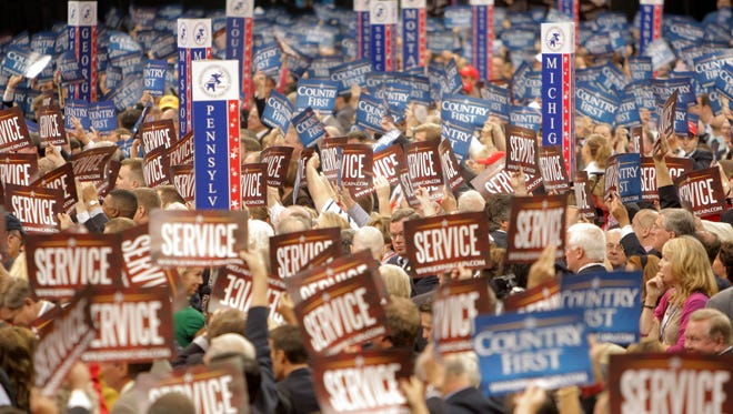 Delegates wave signs during the Republican National Convention in St. Paul, Minn., Tuesday, Sept. 2, 2008.