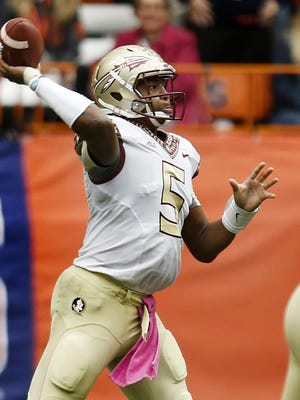 Jameis Winston (5)delivers a strike as the then number 1 ranked Florida State Seminoles cruise 38-20 over the Syracuse Orange on Saturday Oct., 11, 2014 in the Carrier Dome.