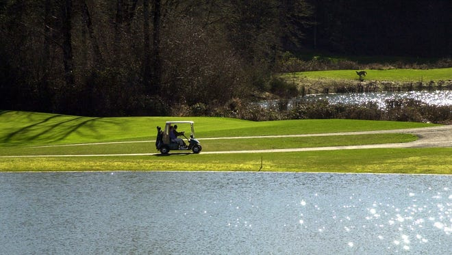 Golfers enjoy a sunny day at Creekside Golf course in this file photo.