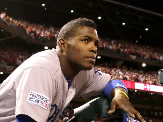 Los Angeles Dodgers' Yasiel Puig watches the St. Louis Cardinals celebrate their 3-2 win over the Dodgers after Game 4 of baseball's NL Division Series Tuesday, Oct. 7, 2014, in St. Louis. (AP Photo/Charles Rex Arbogast)