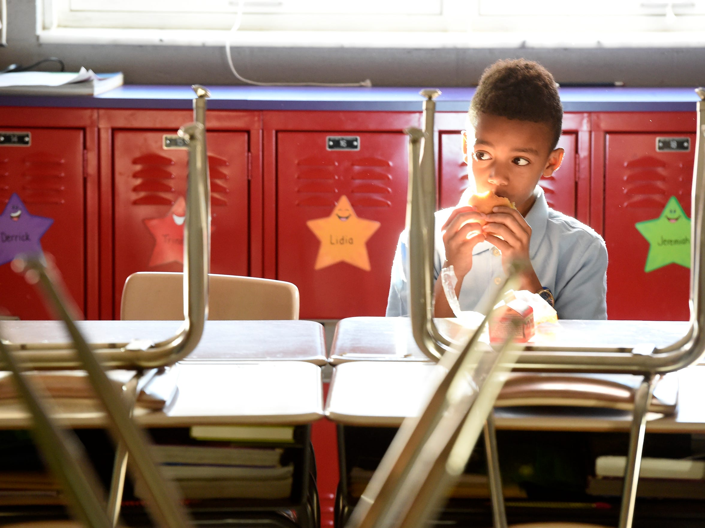 Amqui Elementary School third-grade student Brandon Muhammad eats free breakfast provided by the school at the start of the day in Jennifer Figueredo's classroom Feb. 16, 2017, in Nashville. Figueredo rarely has time to start instruction first thing in the morning. She greets everybody individually, asks them about their night and feeds them breakfast.
