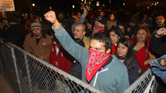 In this file photo, protesters gather at the Tucson Unified School District's headquarters after the governing board voted to cancel the schools' ethnic-studies program in 2012.