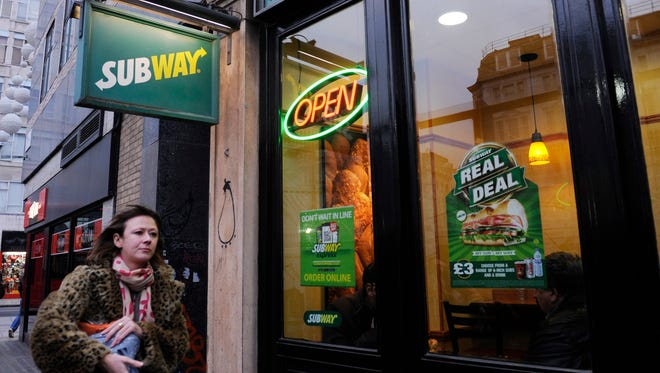 A woman walks past a branch of the sandwich maker Subway in London, Britain, 22 January 2014.
