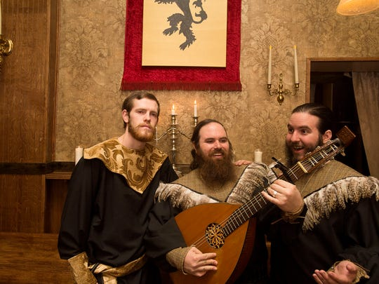 Musical group Matthew Baker, left, Lenny Pettinelli, middle, David Boyd, right, perform at Lex 18's Game of Thrones theater dinner preview April 4, 2016.