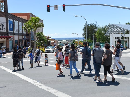 Tourists at a pedestrian scramble in Tumon on May 13, 2018.