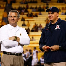 ASU head coach Todd Graham talks to Arizona head coach Rich Rodriguez before kick-off at the 87th Territorial Cup on Saturday, Nov. 30, 2013 in Tempe, AZ.