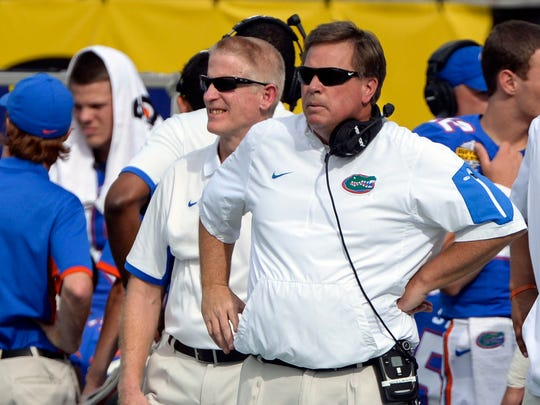 Jim McElwain, then coach of the Florida Gators, works the sideline at the Citrus Bowl on Jan. 1, 2016, in Orlando, against the Michigan Wolverines.
