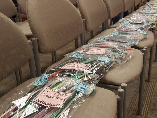 Members of Marco Island's Beach Advisory Committee display a collection of plastic straws gathered during beach clean-ups at the Aug. 15, 2016, City Council meeting. Most of the straws are from South Beach near the resorts, committee members said.