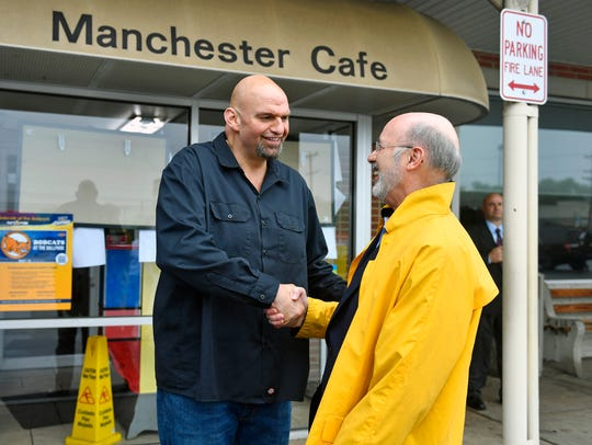 John Fetterman, left, greets Gov. Tom Wolf, right, outside the Manchester Cafe for lunch in this file photo from May 16, 2018.