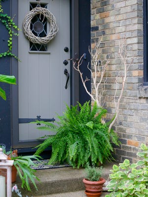 Florist Deb Fowler decorated the porch of her Wauwatosa home with a botanical fall theme.