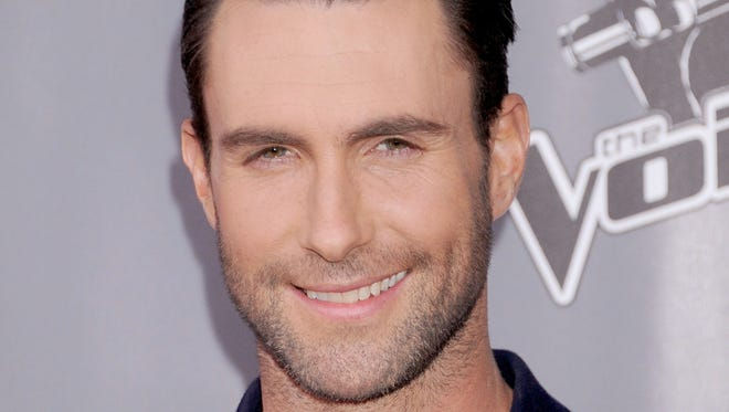 """Singer Adam Levine arrives a red carpet event for """"The Voice"""" at Universal Studios Hollywood on Nov. 7, 2013, in Universal City, Calif."""