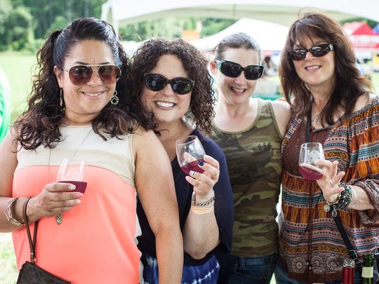 Guests enjoy red wines at the Appel Farm Wine & Music Festival in Elmer.