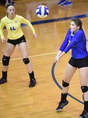 Mountain Home's Ashley Pyeatt, right, makes a pass against West Plains, Mo., on Monday night at The Hangar.