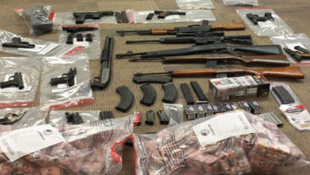 Law enforcement and the DEA seized 1,500 bricks of heroin (75,000 stamped bags), 16 firearms, more than $100,000 in cash and jewelry, two luxury vehicles, Cuban cigars and a live chicken in a house owned by Deshea Townsend.