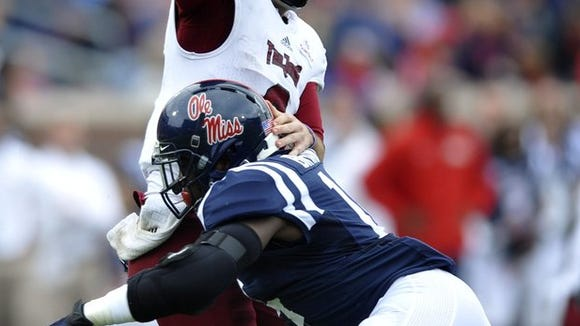 Ole Miss linebacker Serderius Bryant hits the Troy quarterback during a game last season.