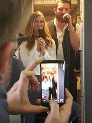 "Chris Young and Cassadee Pope sing ""Think of You"" aboard"