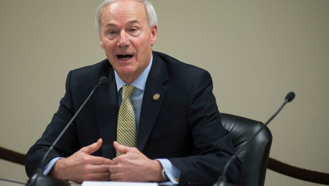 FILE- In this Jan. 4, 2017, file photo Arkansas Gov. Asa Hutchinson speaks to members of the press during a Q&A session in Little Rock, Ark. Hutchinson is a low-key former prosecutor known for delving into policy issues, but he has put himself and his state at the center of the national debate over the death penalty with his extraordinary plan to execute eight men before the end of April. The executions are set to begin Monday, April 17.