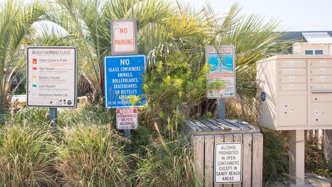 A cluster of signs at Casino Beach in Pensacola on Thursday, September 14, 2017.