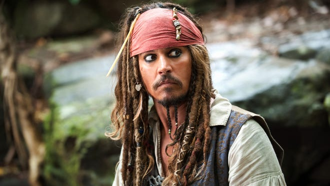 """Johnny Depp portrays Captain Jack Sparrow in a scene from, """"Pirates of the Caribbean: On Stranger Tides."""""""