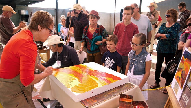 Artists participate in the quick-draw event at the 2013 Art in Kayenta Festival. The 2014 festival will take place Oct. 10-12.