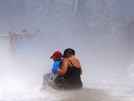Patrons gets splashed at the Padre Plunge area on Friday,
