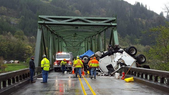 A truck crashed into the Scottsburg Bridge on Highway 38.