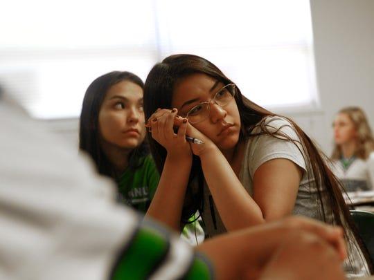 Malika Antez listens during math class Friday at Farmington High School.
