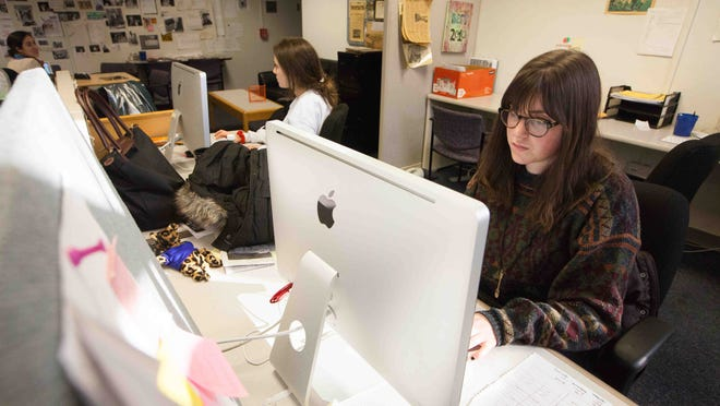 University of Delaware students Hannah Griffin (left) and Krista Adams work at the student newspaper, The Review, on Feb. 23. Students are considering converting completely to a digital publication model.