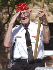 A veteran salutes during a Southern Utah Fourth of