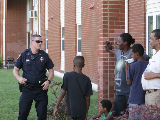 Springfield police officer Kevin Grundy talks to residents
