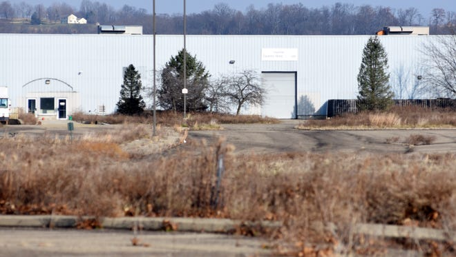 A weedy parking lot stands next to one of the Longaberger buildings recently sold to MPI Group. The company is still in the planning phase for the Frazeysburg facility and no opening date has been set.