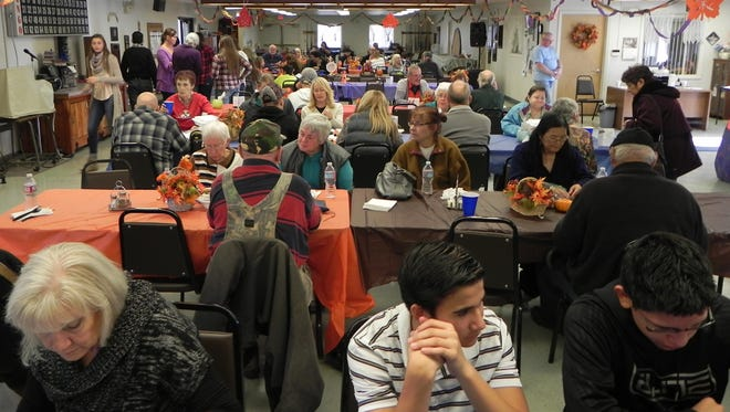 Patrons dine with one another at the Fernley Community Thanksgiving Dinner on Nov. 24.