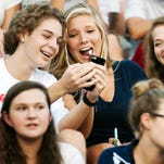 Estero High School students Jake Miller, 14, left, Holly Setterquist, 14, Anna Lebas, 14, and Abby Christopher, 14, enjoy the football game between Estero and Mariner on Friday at Estero High School. Mariner beat Estero 21-14.