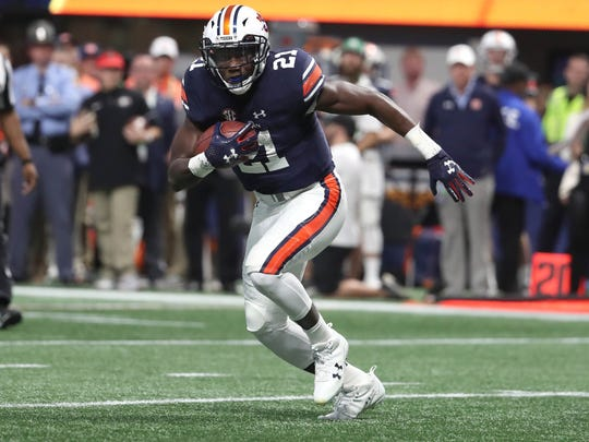 Auburn Tigers running back Kerryon Johnson (21) carries the ball against the Georgia Bulldogs during the SEC Championship game at Mercedes-Benz Stadium.
